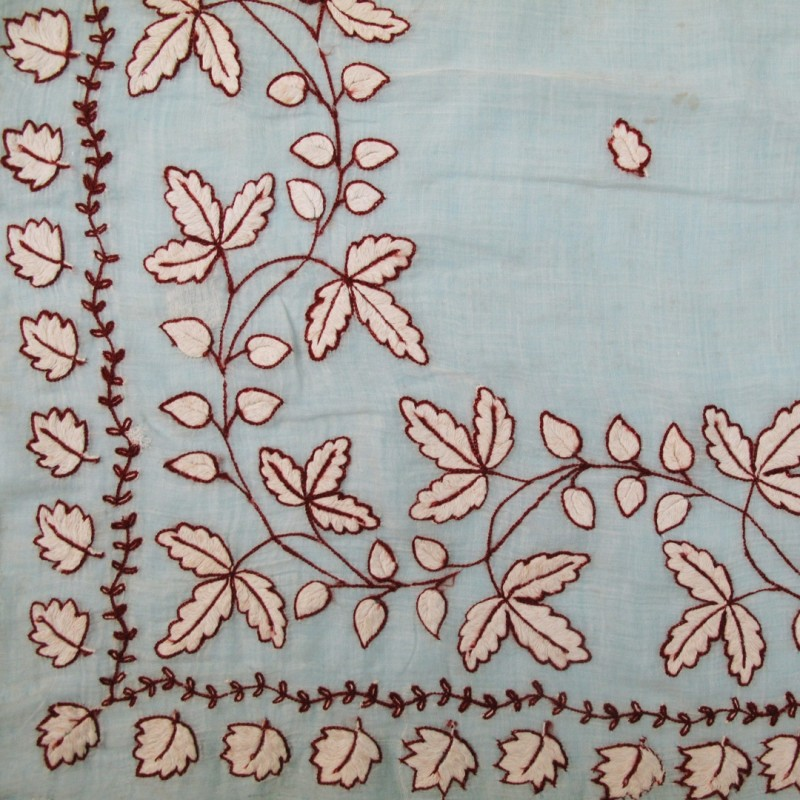 Pale 19th century shawl with delicate embroidery on muslin.