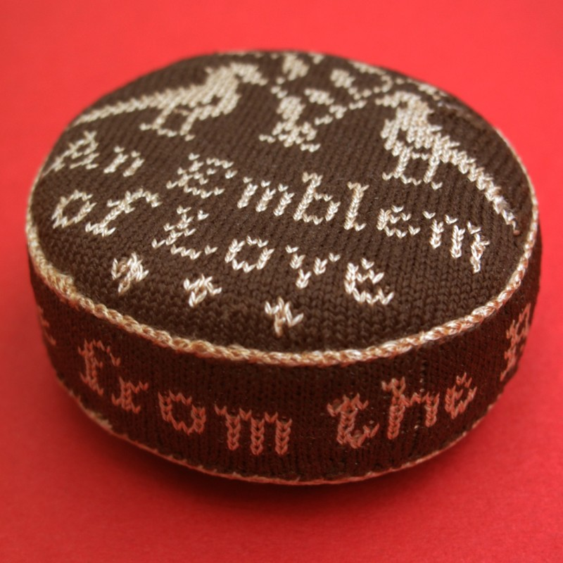 Early stitched emblem of love.