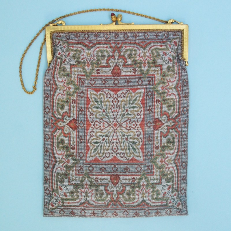 Beautiful early 20th century beaded carpet bag with small coin purse. Made in Paris. The lining has worn but otherwise in good condition.