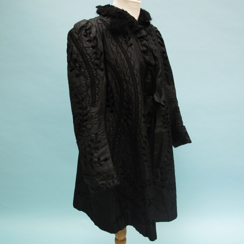 Edwardian black ornate evening coat. Cutout work and jet trimmings.
