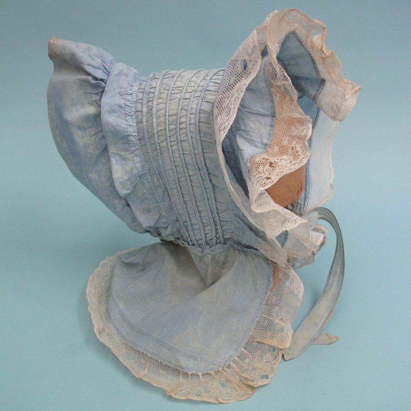 Pale blue 19th century sun bonnet with a lace trim. There is some age-related fading but it would be ideal for TV, film or theatre production.