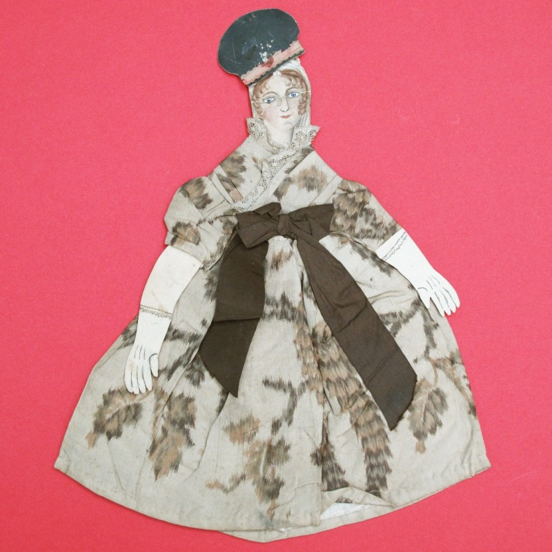 Collection of 19th century home toy theatre paper cut outs. This one has a chine fabric dress.