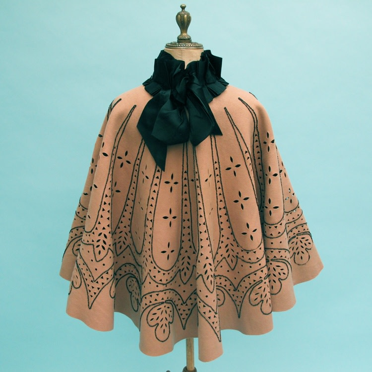 Late 19th century circular cloth cutwork cape outlined with jet beads. Ideal for display due to its graphic design.