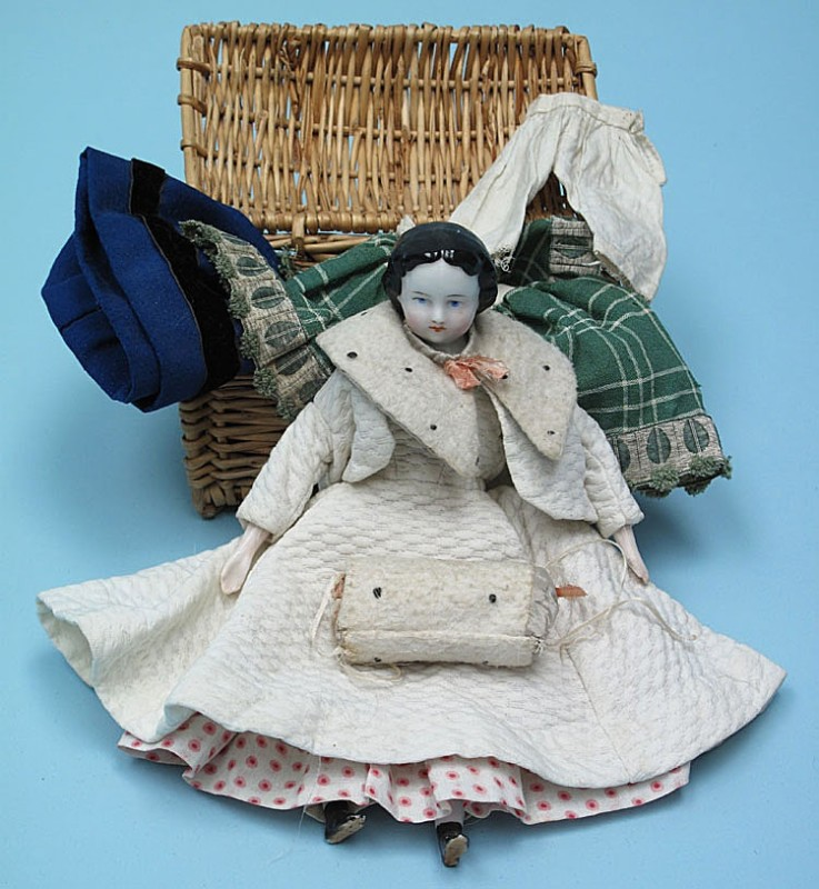 Victorian doll with a selection of clothes.