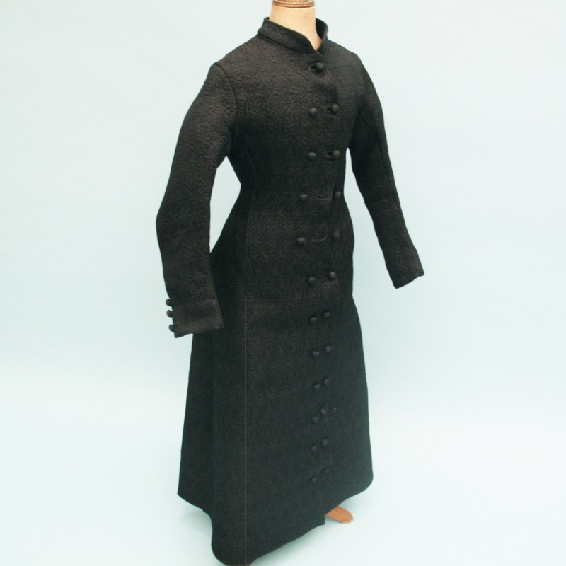 Double buttoned Victorian coat with jet detail on the back.