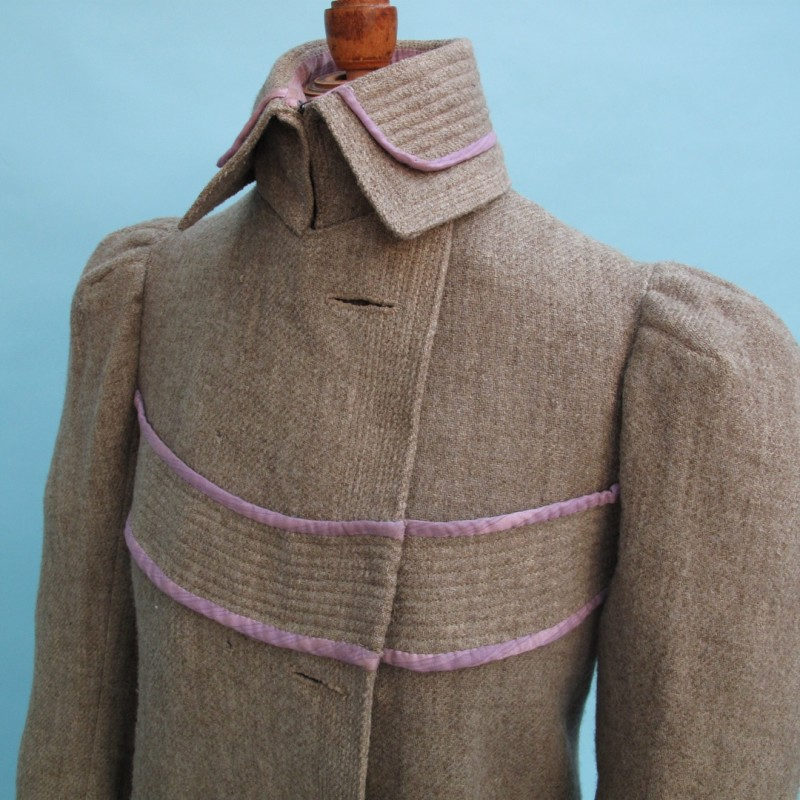 Beautifully tailored Edwardian winter lady's coat. There is some slight age-related damage and the original buttons are missing.