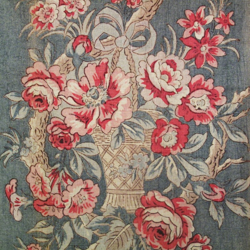 Vintage linen panel printed with rose design in muted shades.