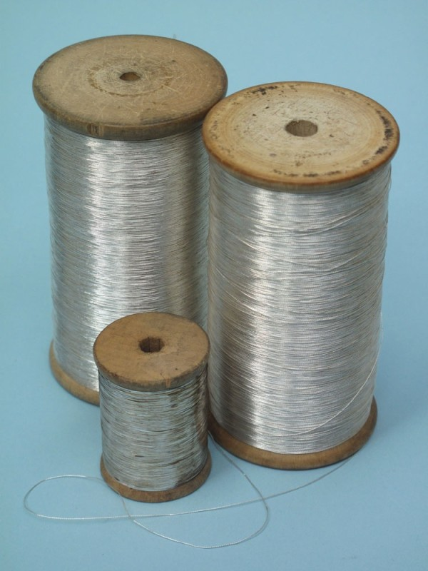 A selection of bullion thread and trimmings in both gold and silver.