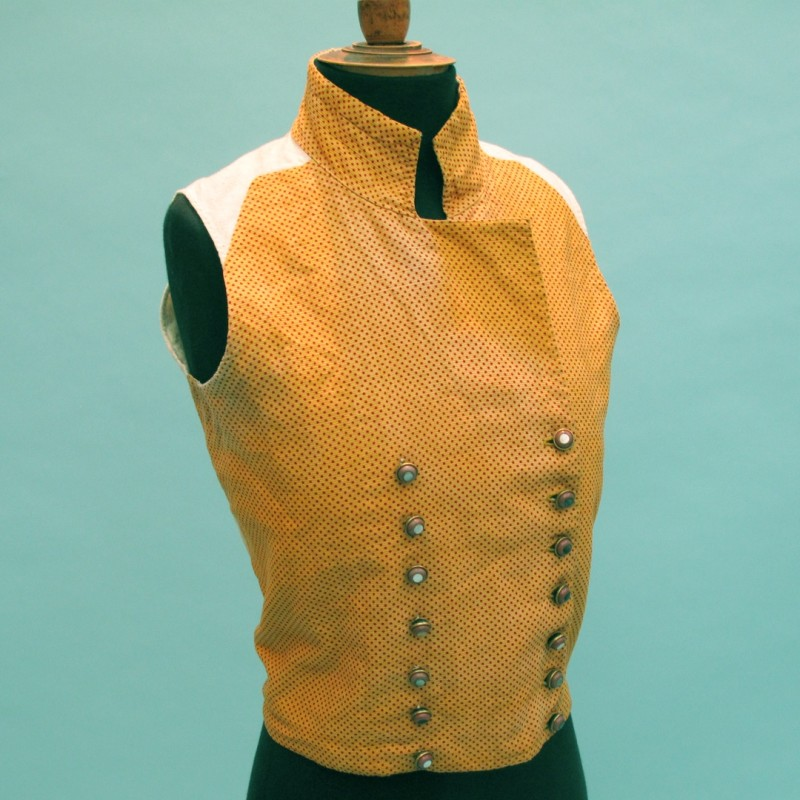 Stylish early 19th century man's waistcoat, yellow and red spot woven cotton with handwoven linen lining. The buttons were probably replaced in the 19th century. On hold