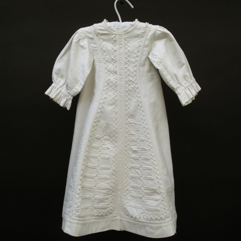 Charming baby's winter gown with delicate embroidery.