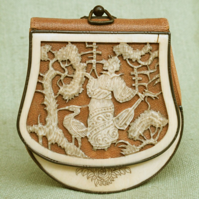 Beautiful leather and bone carved bag made in Asia, circa 1880.