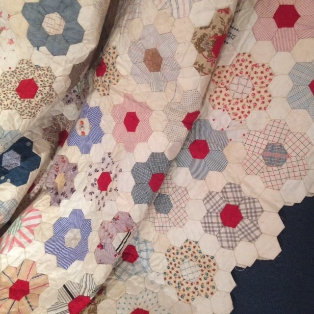 Lovely patchwork quilt measuring approx 2 mtrs x 1.6 mtrs.