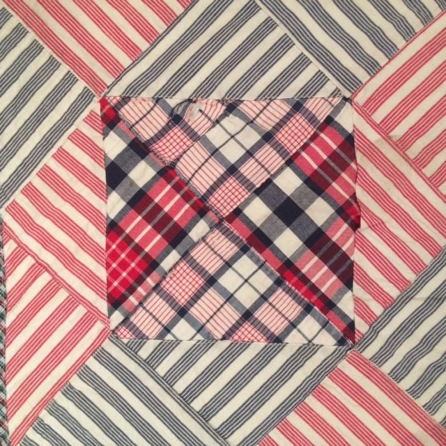 Very striking red and blue striped quilt with a red border. Sold