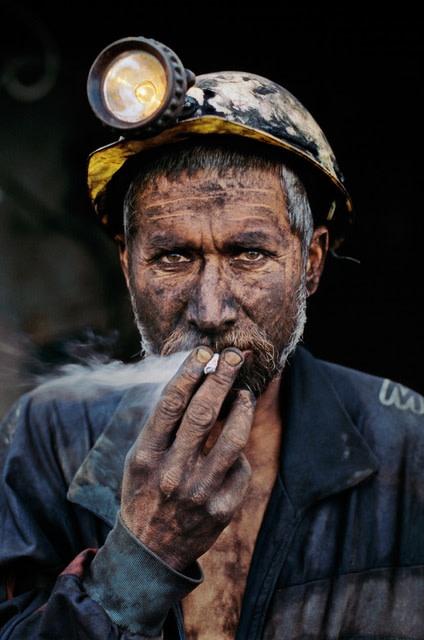 Steve Mccurry, SMOKING COAL MINER, POL-E-KHOMRI, AFGHANISTAN, 2002
