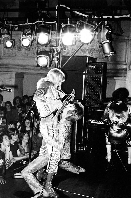 Mick Rock, DAVID BOWIE AND MICK RONSON, GUITAR FELLACIO, OXFORD TOWN HALL, UK, 1972