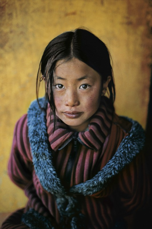 Steve McCurry, GIRL IN A NEW COAT, XIGAZE, TIBET, 2001