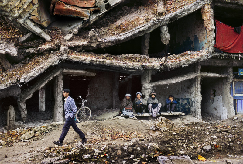 Steve McCurry, REGUGEES SHELTER IN DESTROYED BUILDING, AFGHANISTAN, 2002