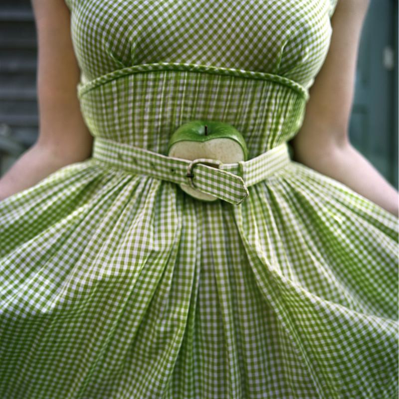 CIG HARVEY, CUT APPLE AND GINGHAM DRESS, SELF PORTRAIT, CLARK'S ISLAND, MAINE, 2003