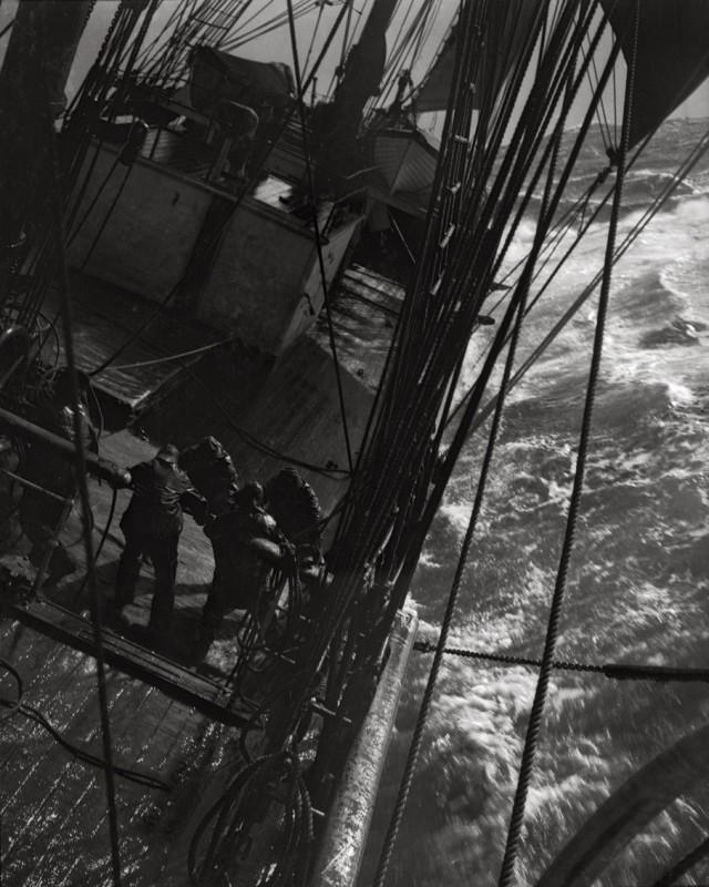 Herbert Ponting, AT THE PUMPS IN A GALE IN ANTARCTIC OCEAN, MARCH 1912