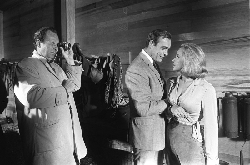 Terry O'Neill, GUY HAMILTON, SEAN CONNERY AND HONOR BLACKMAN ON THE SET OF 'GOLDFINGER', PINEWOOD STUDIOS, 1964