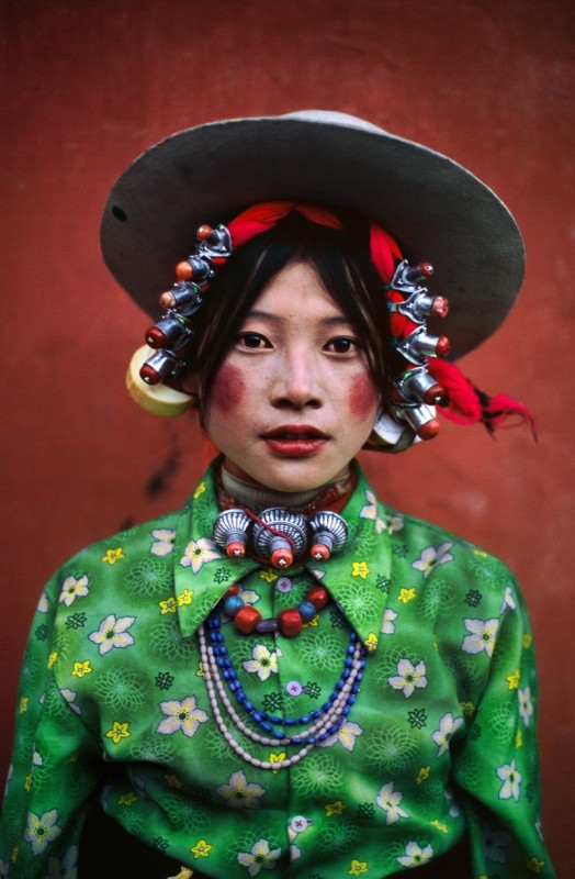 Steve McCurry, WOMAN AT A HORSE FESTIVAL, TAGONG, TIBET, 1999