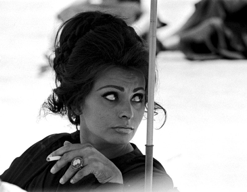 Terence Donovan, SOPHIA LOREN SMOKING, TAKEN ON THE SET OF ANTHONY MANN'S 'THE FALL OF THE ROMAN EMPIRE', SPAIN, 19 - 22 MAY, 1963