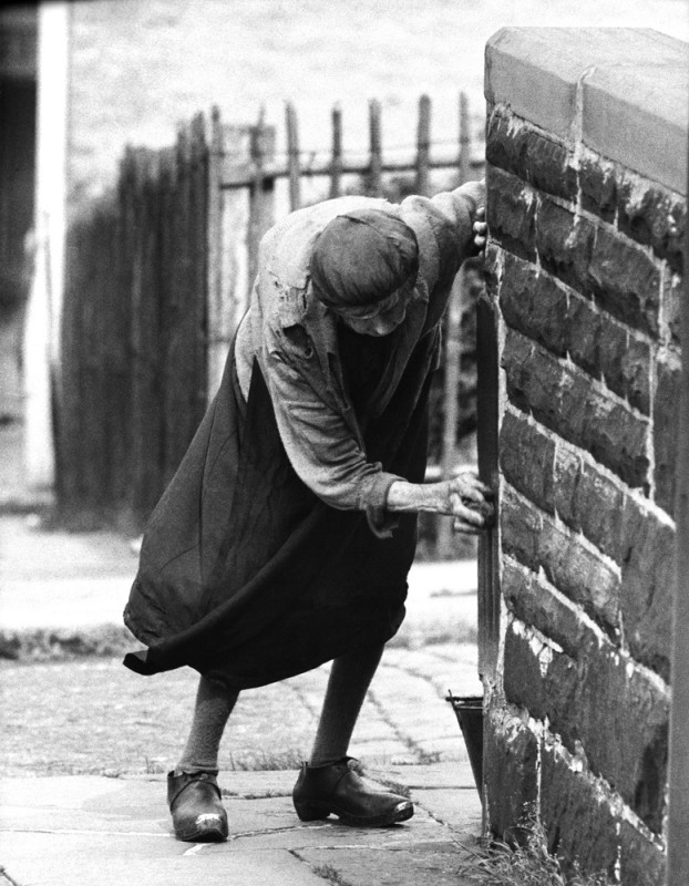 John Bulmer, LADY SCRUBBING GATE POST, NELSON, 1960