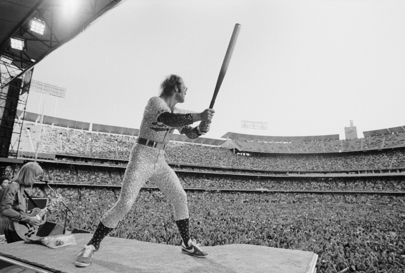 Terry O'Neill, ELTON JOHN IN FULL SWING, DODGER STADIUM, LOS ANGELES, 1975