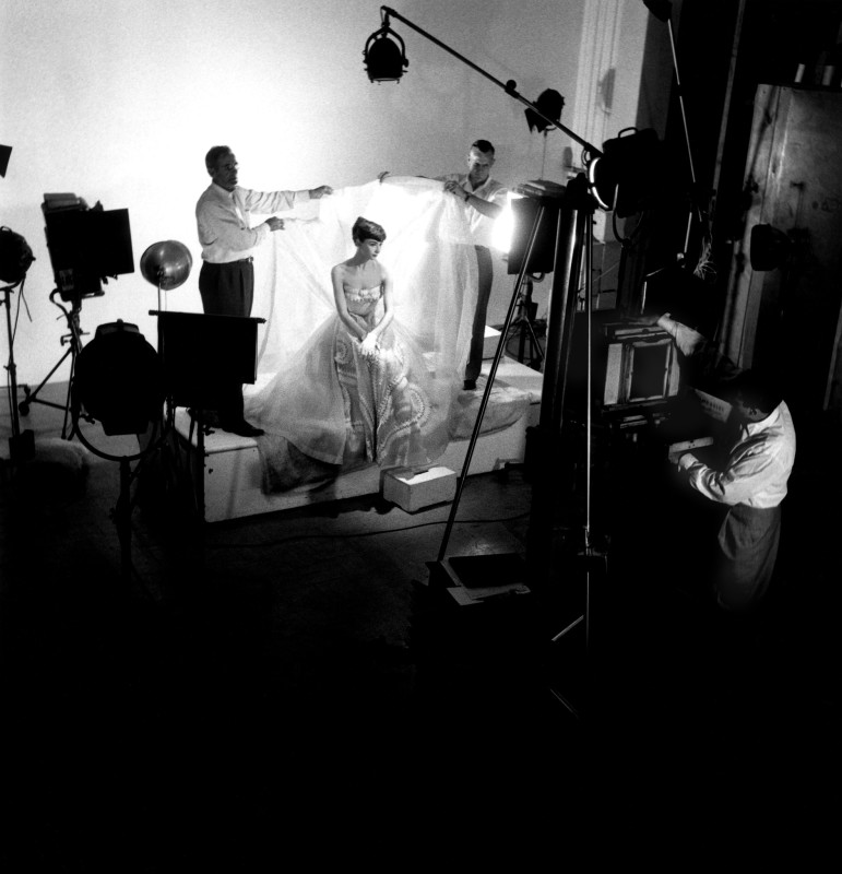 Bob Willoughby, AUDREY HEPBURN BEING PHOTOGRAPHED IN THE PORTRAIT GALLERY, PARAMOUNT STUDIOS, 1953