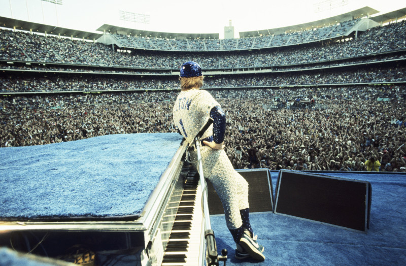 Terry O'Neill, ELTON JOHN, DODGER STADIUM, LOS ANGELES, 1975