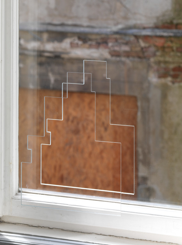 """Ryan Gander<br><b>Am I naked too?</b>, 2011<br>Architectural intervention, 31,7 x 25 cm<br><br>An aperture cut into an interior or exterior wall, door or window glazing, the aperture being the exact shape and dimensions of a sculpture by Georges Vantongerloo entitled """"Construction of Volumetric Interrelationships Derived from the Inscribed Square and the Square Circumscribed by a Circle,"""" 1924, The Solomon R. Guggenheim Foundation, Peggy Guggenheim Collection.<br>"""
