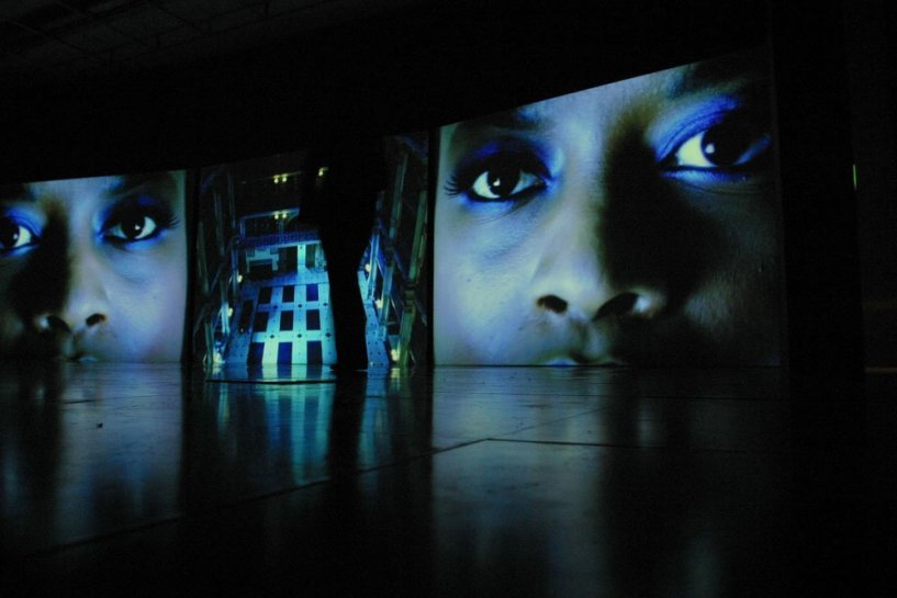 "<div id=""slideshowCaption""><span>Baltimore, 2003 (Installation View </span>September 2003)<br /> <em>Triple DVD projection, 16mm film transferred to 3x DVDs, Duration 11 min 56 sec </em><br /><br /></div>"