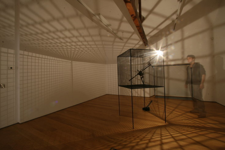 "<p>Conrad Shawcross, Slow Arc inside a Cube II, 2008<br /><em>Light, steel, mechanical CNC system, <span style=""line-height: 1.5em;"">93 x 93 x 147 cm </span><span style=""line-height: 1.5em;"">36 5/8 x 36 5/8 x 57 7/8 in</span></em></p>"