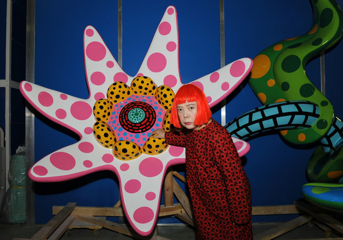 Yayoi Kusama with a new flower sculpture, 2010 (production shot)