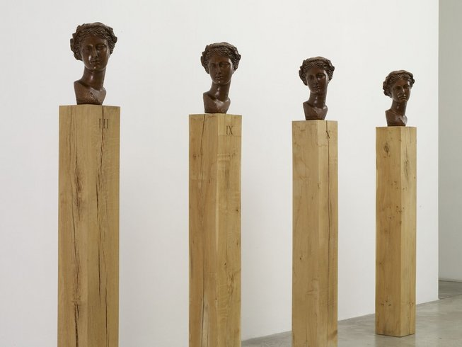 <p>Four Muses, 2006<br /><em>Bronze heads on green oak plinths, head 36 x 24 x 24 cm, plinths 20 x 20 x 140 cm</em></p>