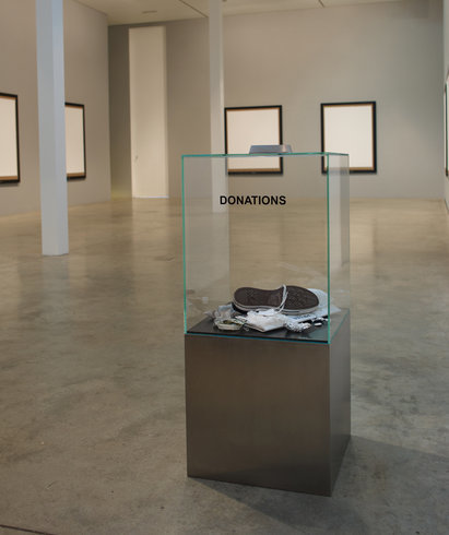 "<p>Donation Box, 2006<br /><em>Glass, stainless steel, various objects, <span style=""line-height: 1.5em;"">105 x 44.5 x 44.5 cm </span><span style=""line-height: 1.5em;"">41 3/8 x 17 1/2 x 17 1/2 in</span></em></p>"