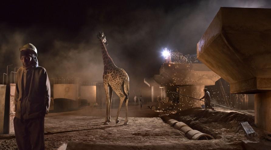 <span class=&#34;artist&#34;><strong>Nick Brandt</strong></span>, <span class=&#34;title&#34;><em>Bridge Construction with Giraffe & Worker</em>, 2018</span>
