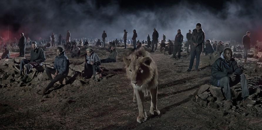 "<span class=""artist""><strong>Nick Brandt</strong></span>, <span class=""title""><em>Savannah with Lion & Humans </em>, 2018</span>"