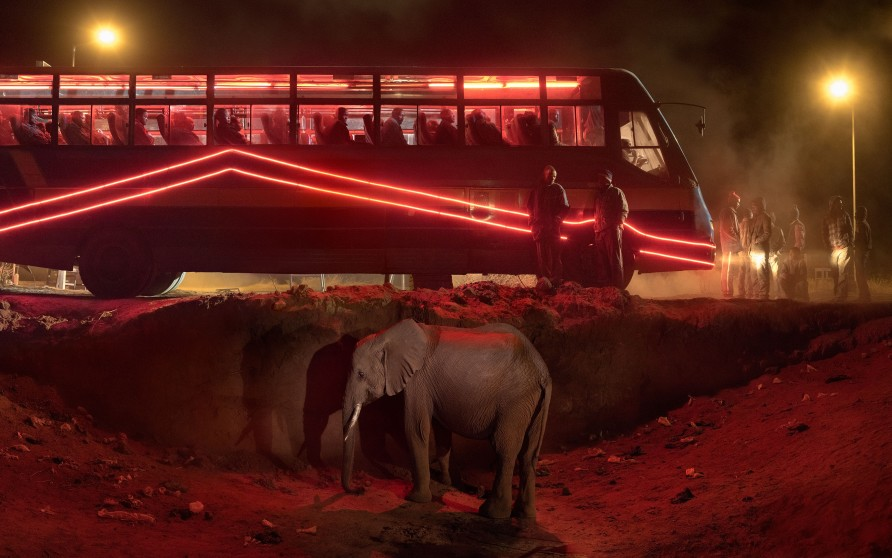 <span class=&#34;artist&#34;><strong>Nick Brandt</strong></span>, <span class=&#34;title&#34;><em>Bus Station with Elephant and Red Bus</em>, 2018</span>