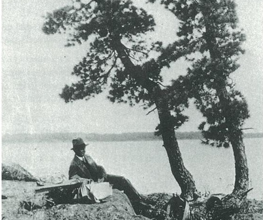Fig. 2J.E.H. MacDonald sketching under the shade of a poplar tree during his trip to Sturgeon Bay in 1931.