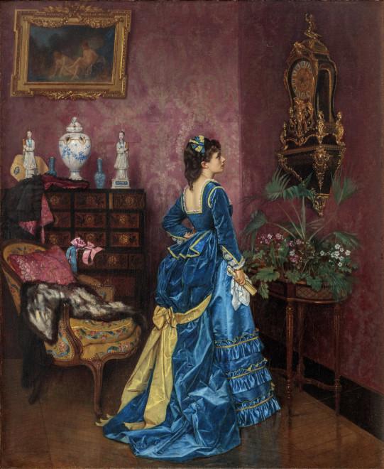 ELEGANT WOMAN IN AN INTERIOR