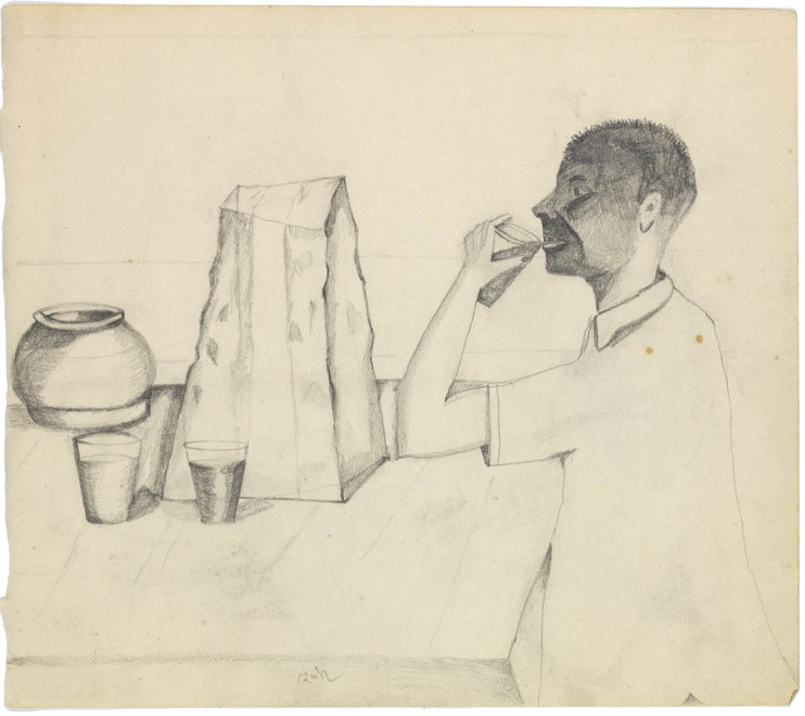 Man Drinking at Table