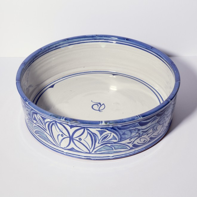 Large straight-sided dish with dogs and hares