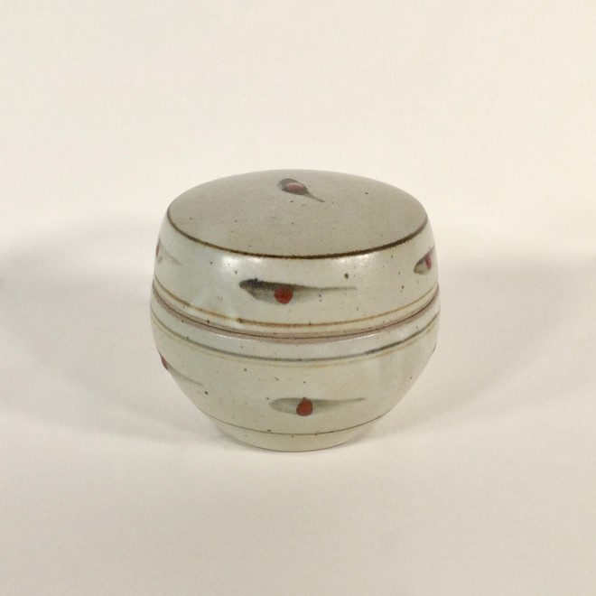 A lidded pot with dot pattern
