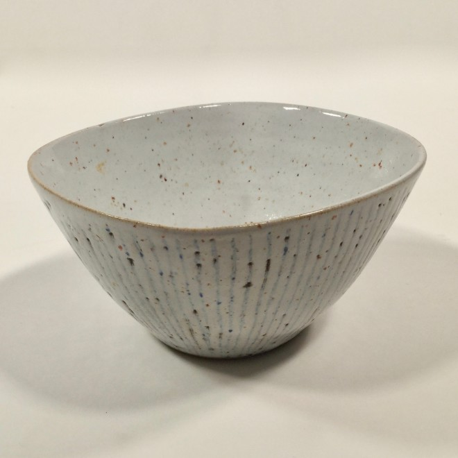A squared bowl with 'oatmeal' glaze over sgraffito lines