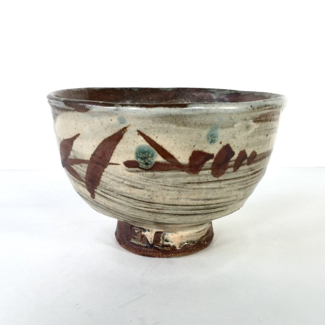 Footed bowl with rushes
