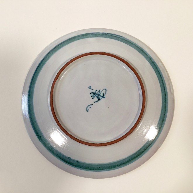 An Aldermaston Pottery dish with a feather motif