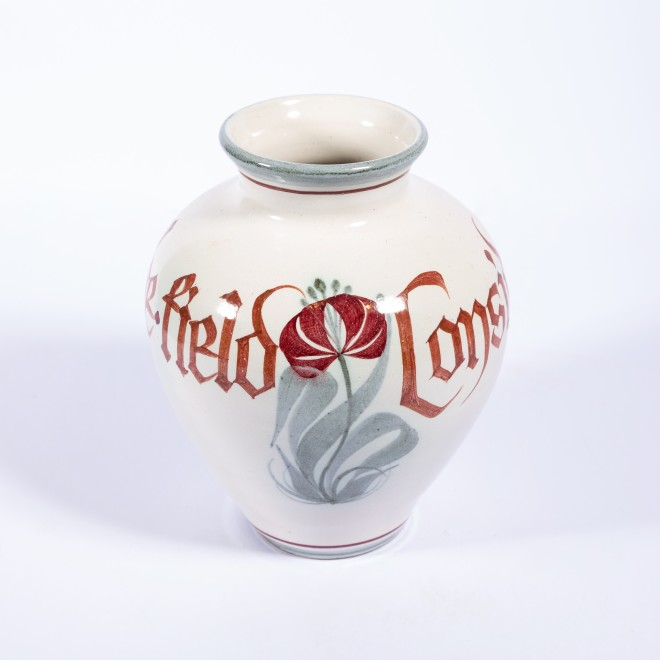 An onion-shaped vase with inscription