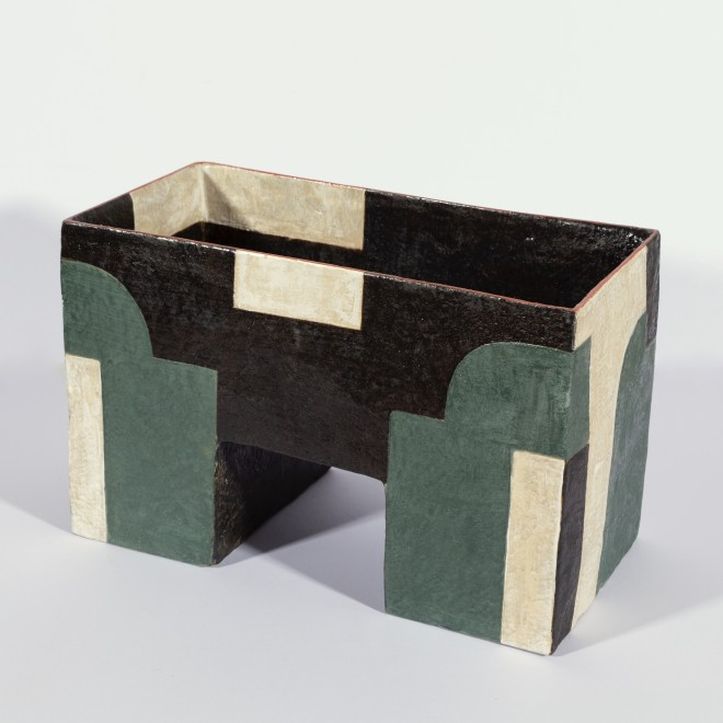Angular vessel with green abstracts