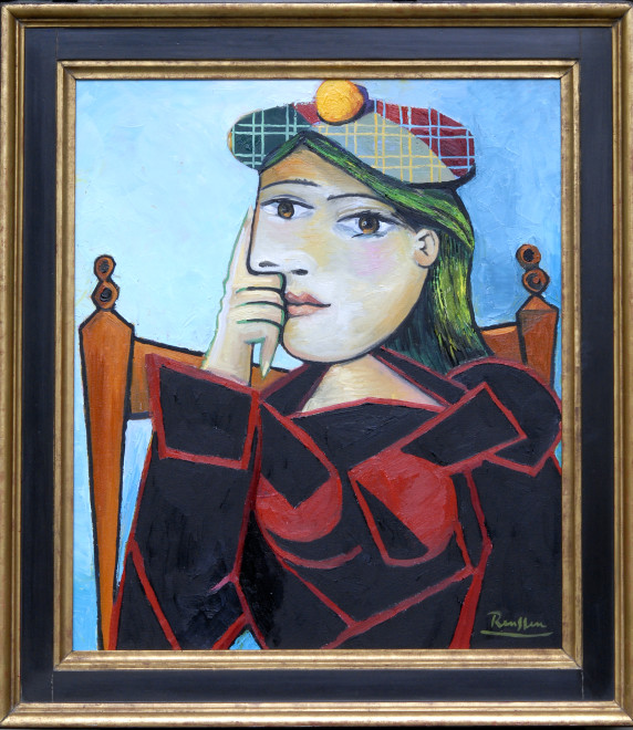 Seated woman in a green and red baret